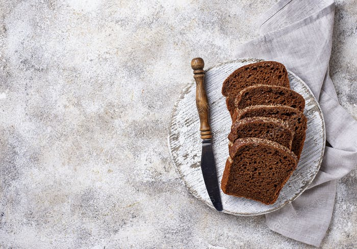 Fresh sliced rye bread on light background