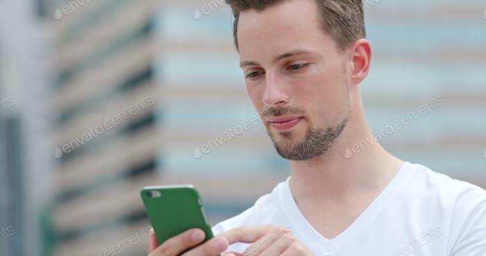 Caucasian man look at mobile phone