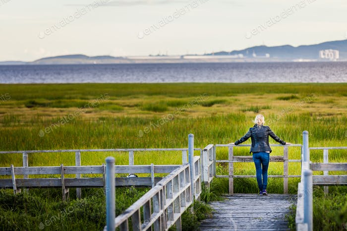 Lonely Young Woman Looking at the Amazing Calm Landscape from a