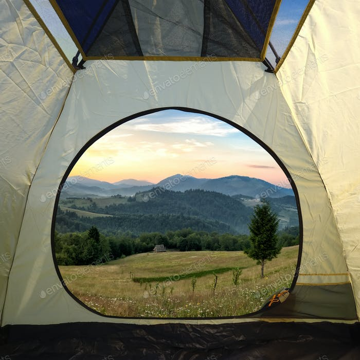 View from inside a tent on mountains landscape