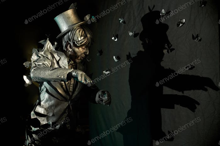 Side view of professional mime performing at pantomime act