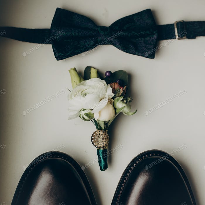 Stylish wedding bow tie with modern flowers bouquet and shoes