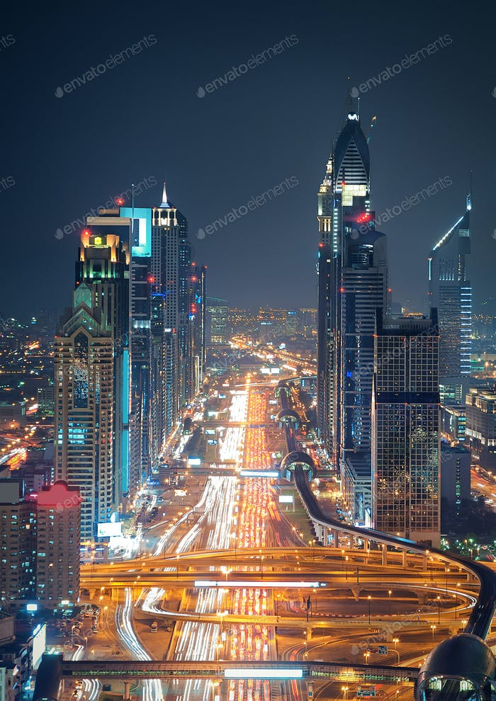 Amazing night dubai downtown skyline and road leading to Abu Dhabi, Dubai, United Arab Emirates