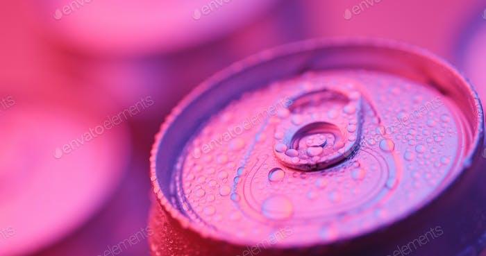 Aluminum beverage can under purple lighting