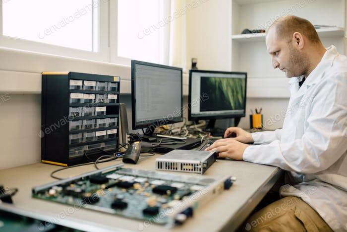Technician repairing cmts cards