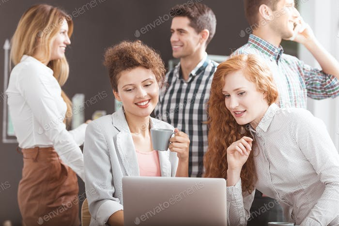 Women working together on laptop