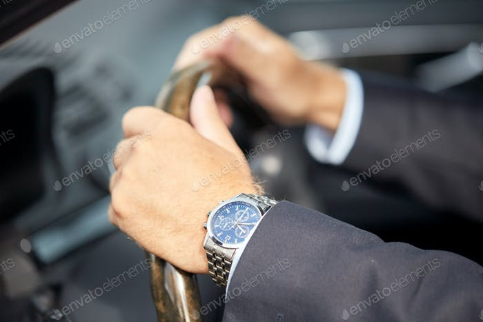 senior businessman hands driving car