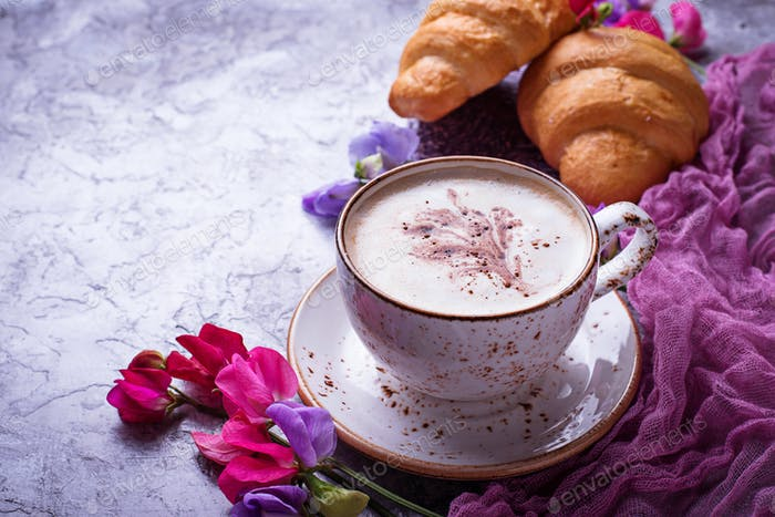 Coffee, croissants and flower.
