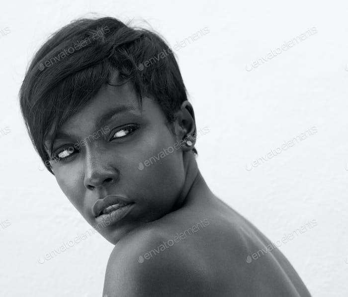 Black female fashion model posing on white background