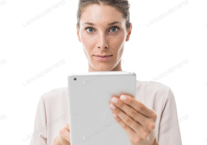 Woman using a touch screen tablet