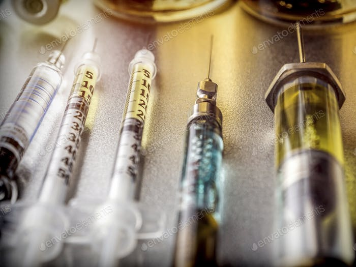 several syringes in operating theater of a hospital, conceptual image