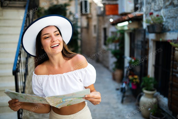 Happy young woman smiling and traveling at summer vacation
