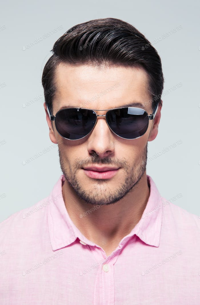 Portrait of a fashion young man in sunglasses