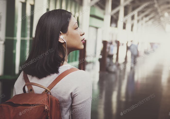 Asian Lady Traveler Rucksack City Concept