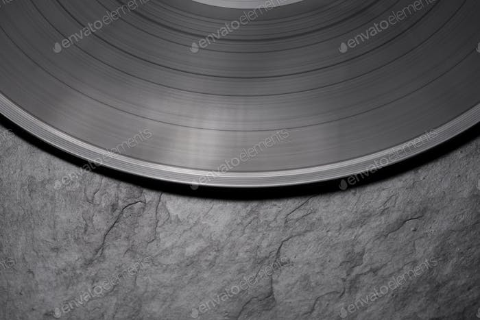 Close-up shot of vinyl record on black background.