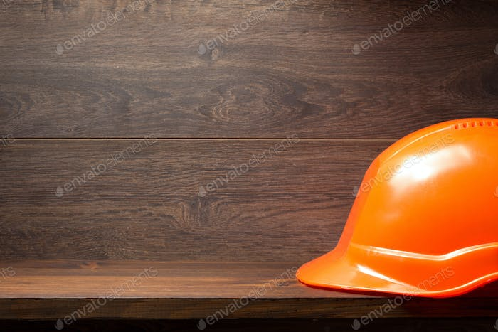hard hat helmet on wooden shelf