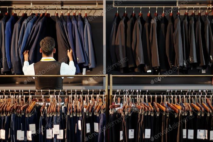 Man checking jackets on hanger