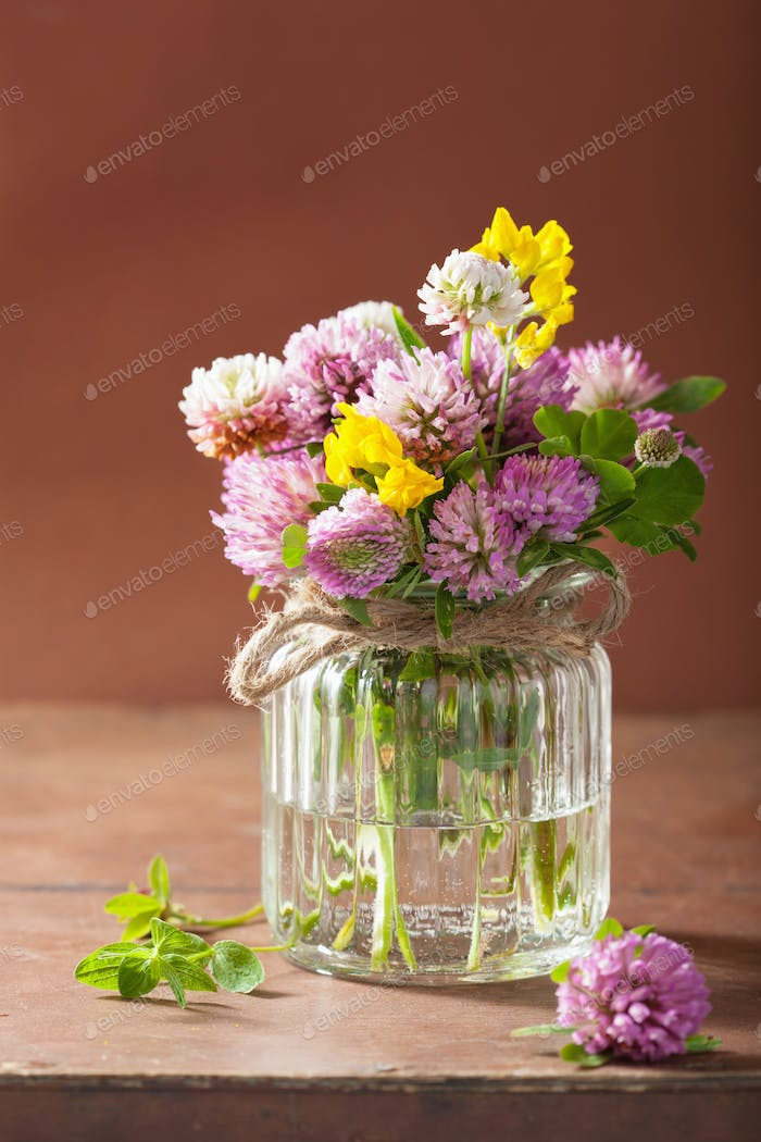 colorful medical flowers and herbs in glass jar
