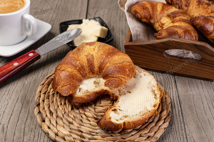 Fresh croissants with butter