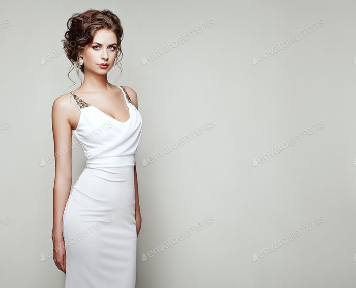 Fashion portrait of beautiful woman in elegant dress