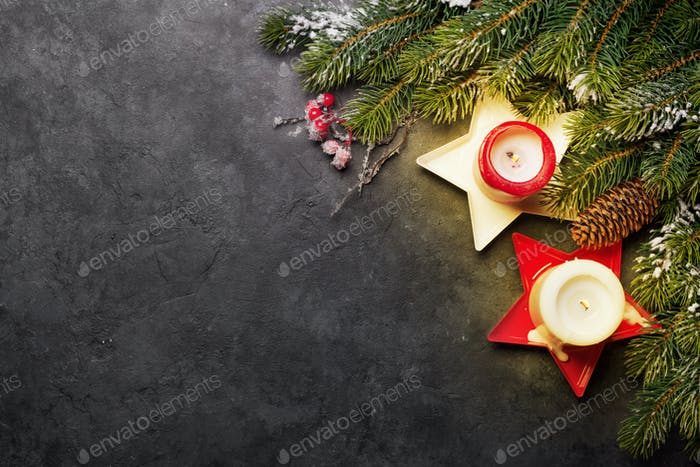 Christmas greeting card with fir tree and candles