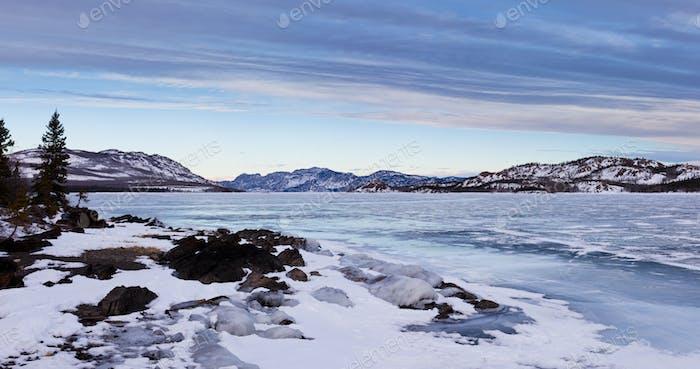 Panorama of frozen Lake Laberge Yukon T Canada