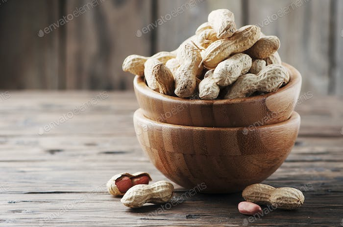 Paenut in the bowl in the wooden table