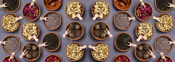 Set of different dry tea in wooden bowl