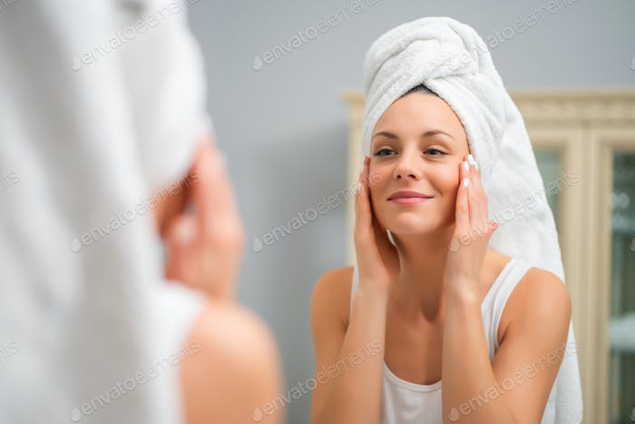 Woman looking at her skin