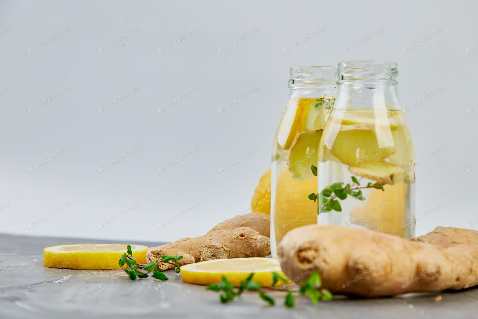 Detox Water In Bottles With Ingredients Ginger Lemon Mint Photo By