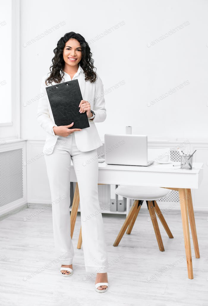 Full length image of latin woman with clipboard