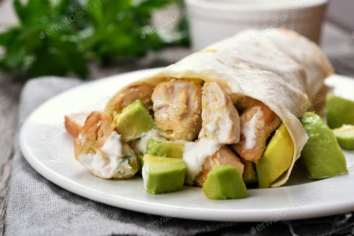 Wrap sandwich with chicken and avocado