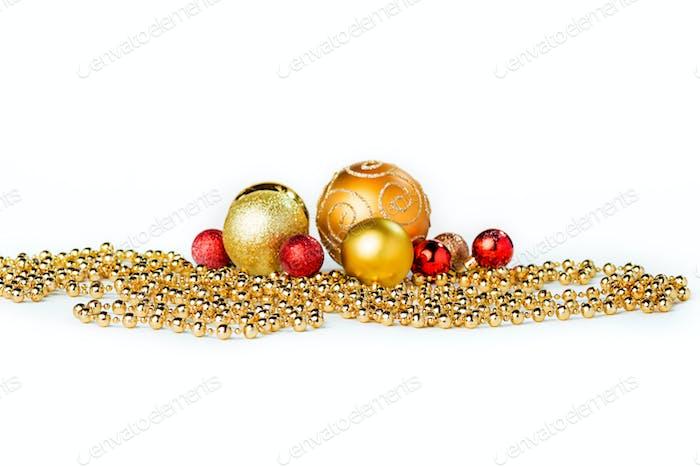 Gold Christmas balls on white
