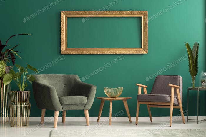 Armchairs in green living room