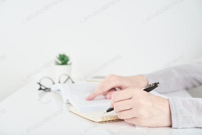 Woman searching information in book, Office Work Concept on white wall background
