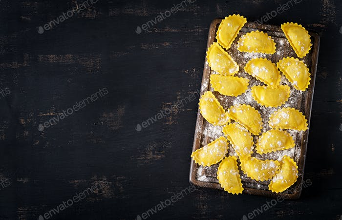Uncooked ravioli on table. Italian cuisine. Top view