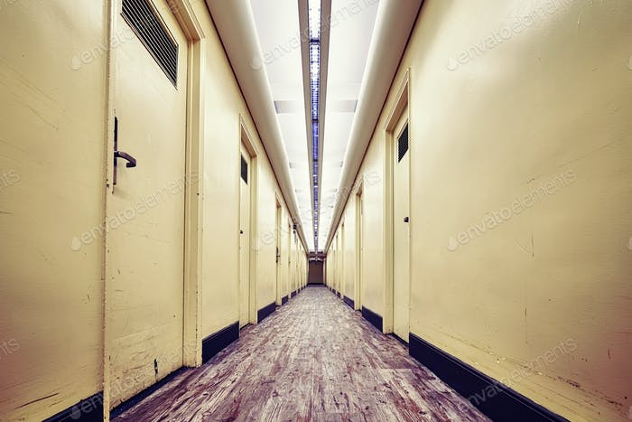 Empty corridor in an old building, color toned picture