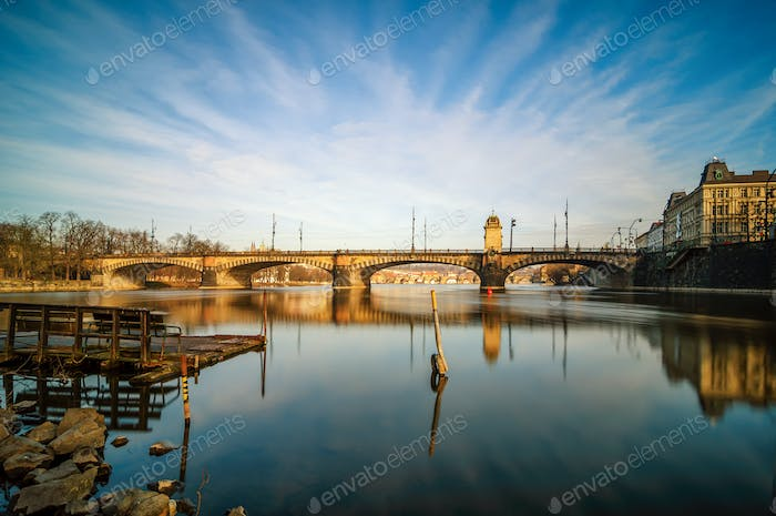 Amazing sunrise view at Vltava river bridge and boat with clear