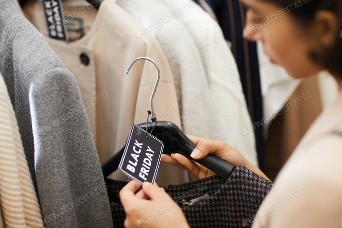 Young Woman Buying Clothes on Sale