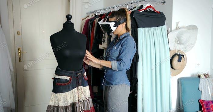 Female tailor in VR headset