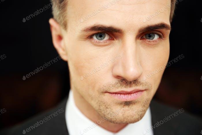Closeup portrait of a confident businessman at office