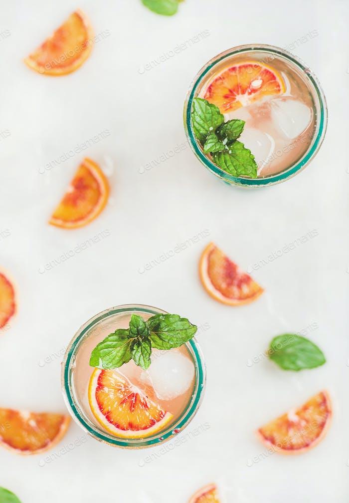 Blood orange fresh summer lemonade in glasses, top view
