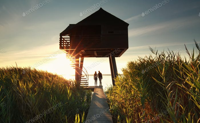 couple by wooden observing tower