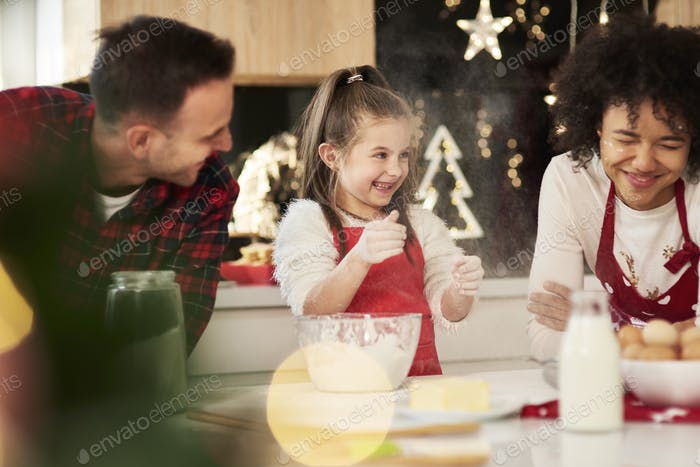Family enjoying in the kitchen at Christmas