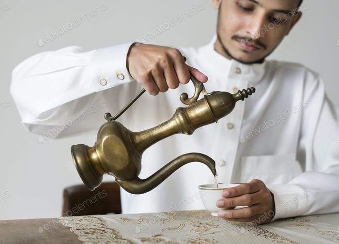 Muslim man having a cup of tea