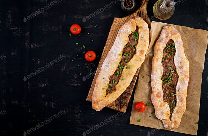 Turkish pide with minced meat, Kiymali Pide. Traditional Turkish cuisine.
