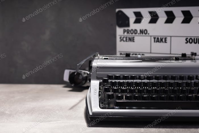 vintage retro typewriter, film camera and movie clapper board