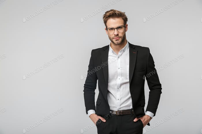 Portrait of handsome businessman posing and looking at camera