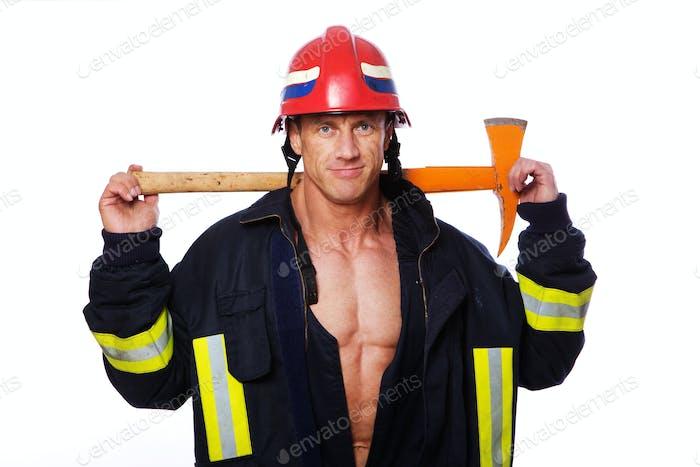 Portrait of fireman posing on white background
