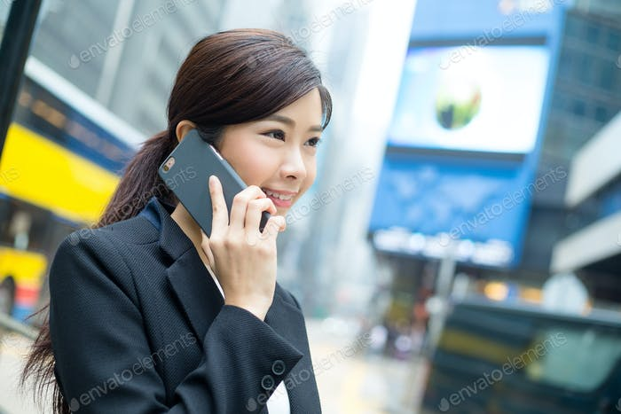 Business woman talk to smart phone